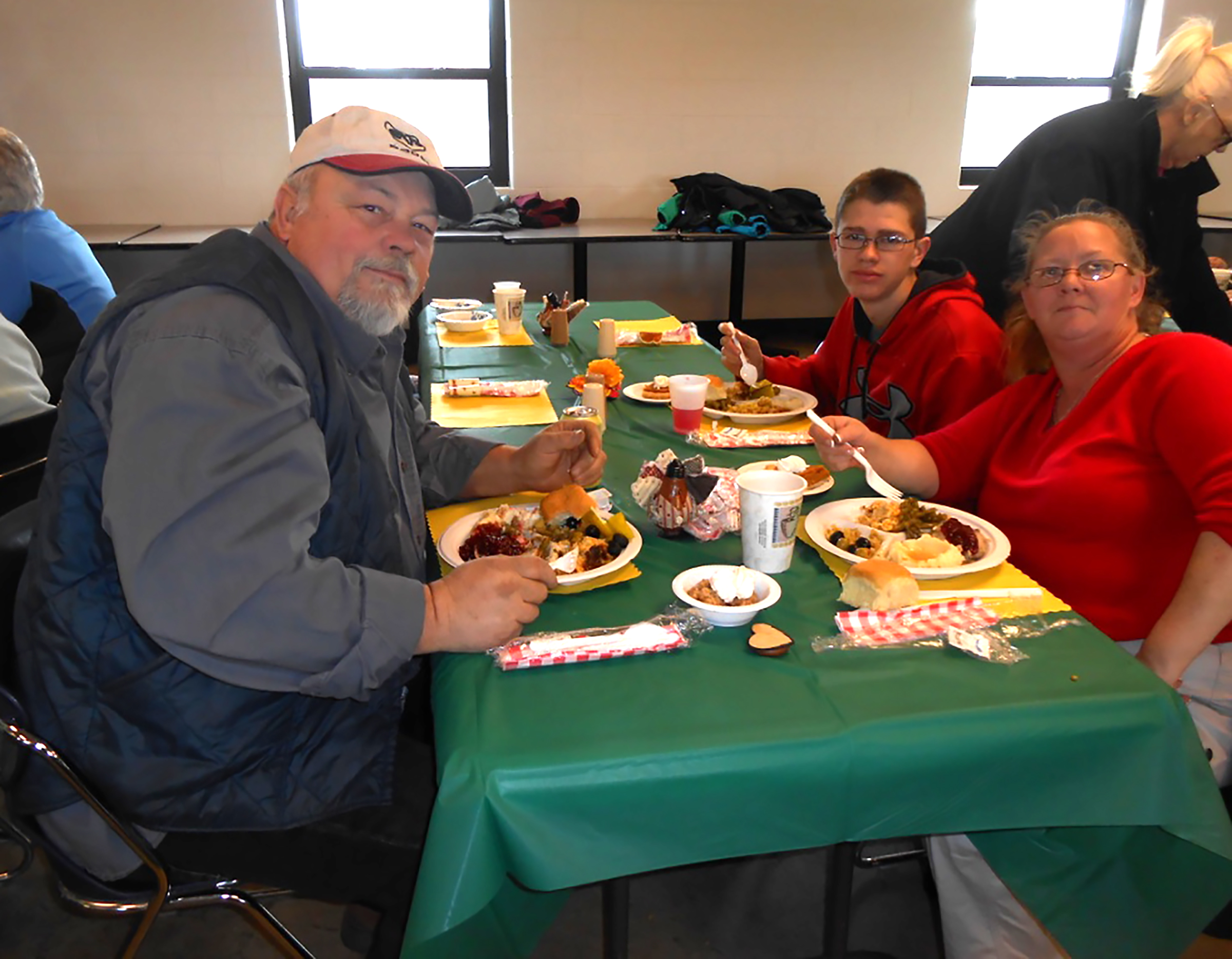Mike Beanes, Sharon Bunker and Blake Berridge enjoy their meals at the dining hall located at the airfield.