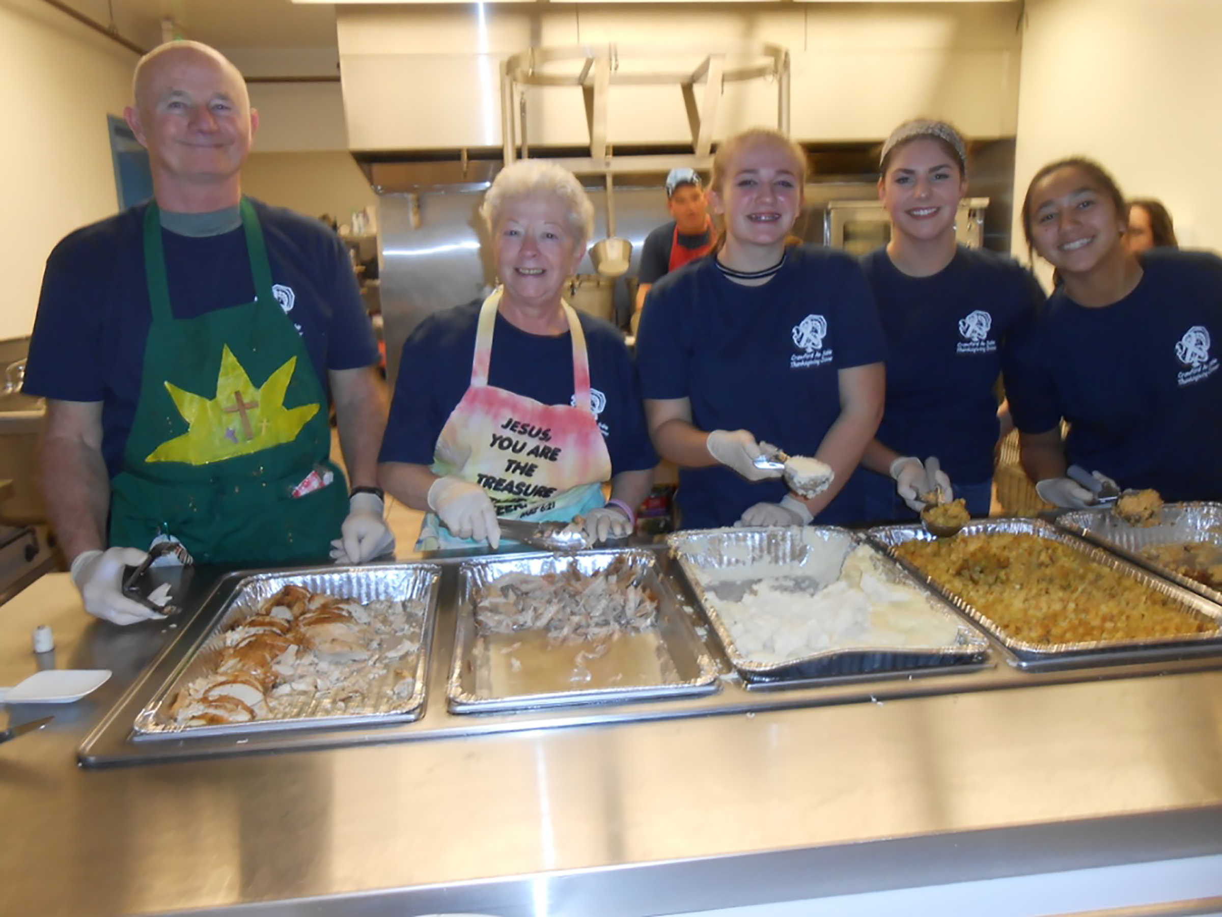 Above, this group of volunteers served up hot meal items to the area residents who were served dine-in meals at the Grayling Army Airfield.